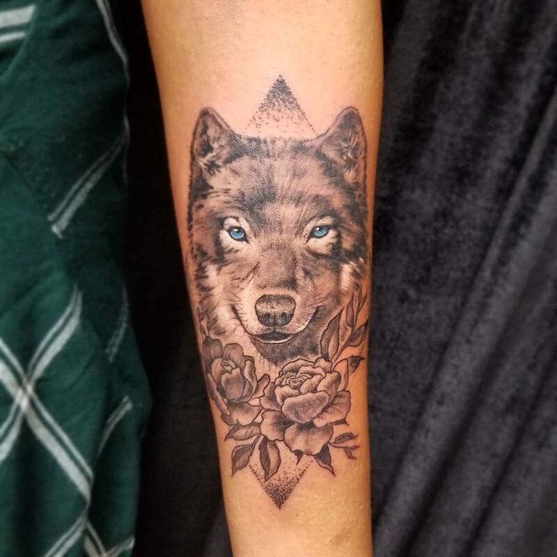 Wolf with flower tattoo done at Overlord Tattoo Shop in Miami Beach